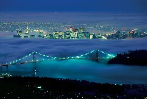 Aerial-view-of-Lions-Gate-Bridge-in-fog-and-Vancouver-skyline-at-night-©-Tourism-British-Columbia